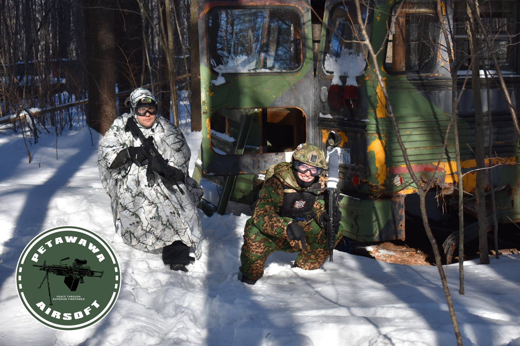 Image of 2 players in the snow in camouflage