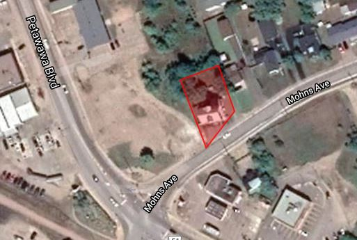 an aerial view of a parcel of property highlighted in red