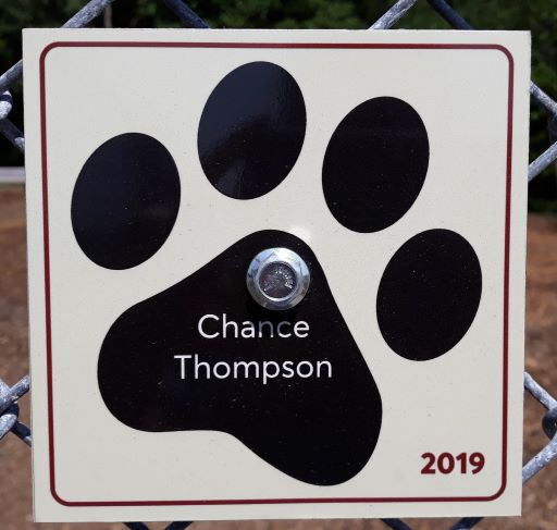 image of dog paw with dog's name and year inscribed