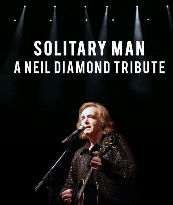 Neil Diamond singing on stage