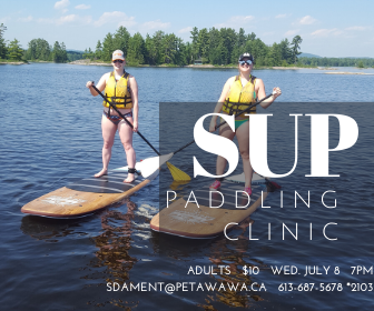 Image of 2 adults on SUP boards on the Ottawa River
