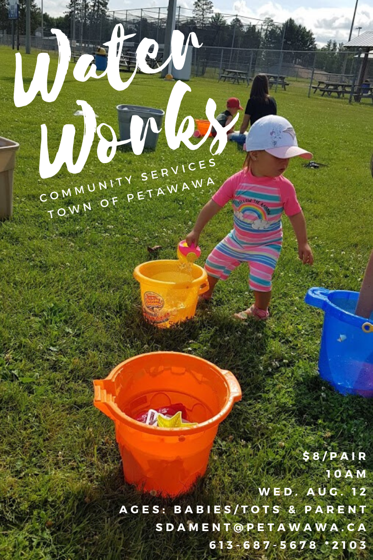 Image of toddlers playing with bucket and waters on a grass field