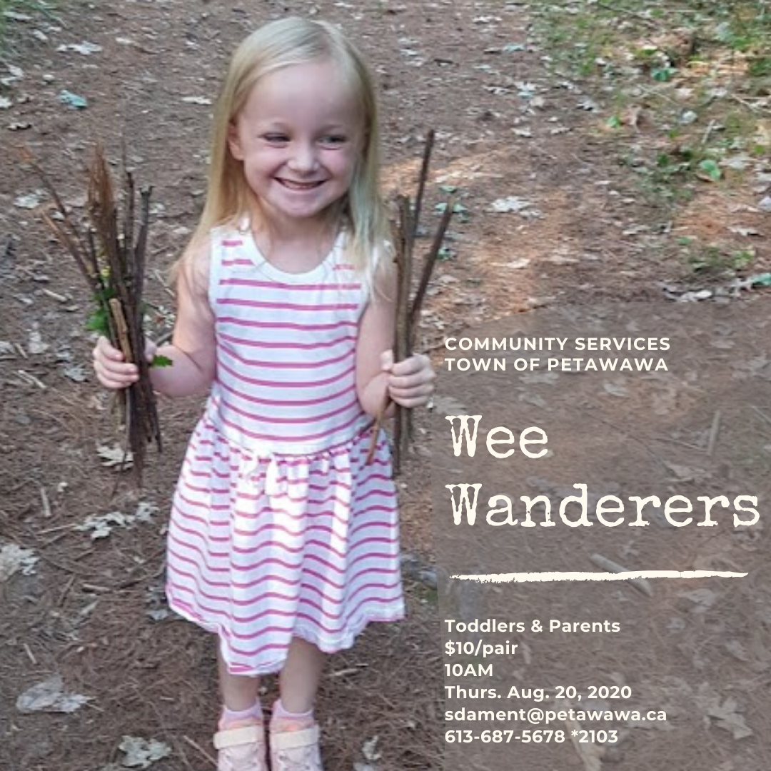 Image of smiling toddler holding twigs in both hands