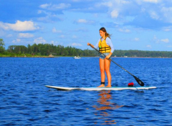 Image of a young woman on a SUP board on the Ottawa River