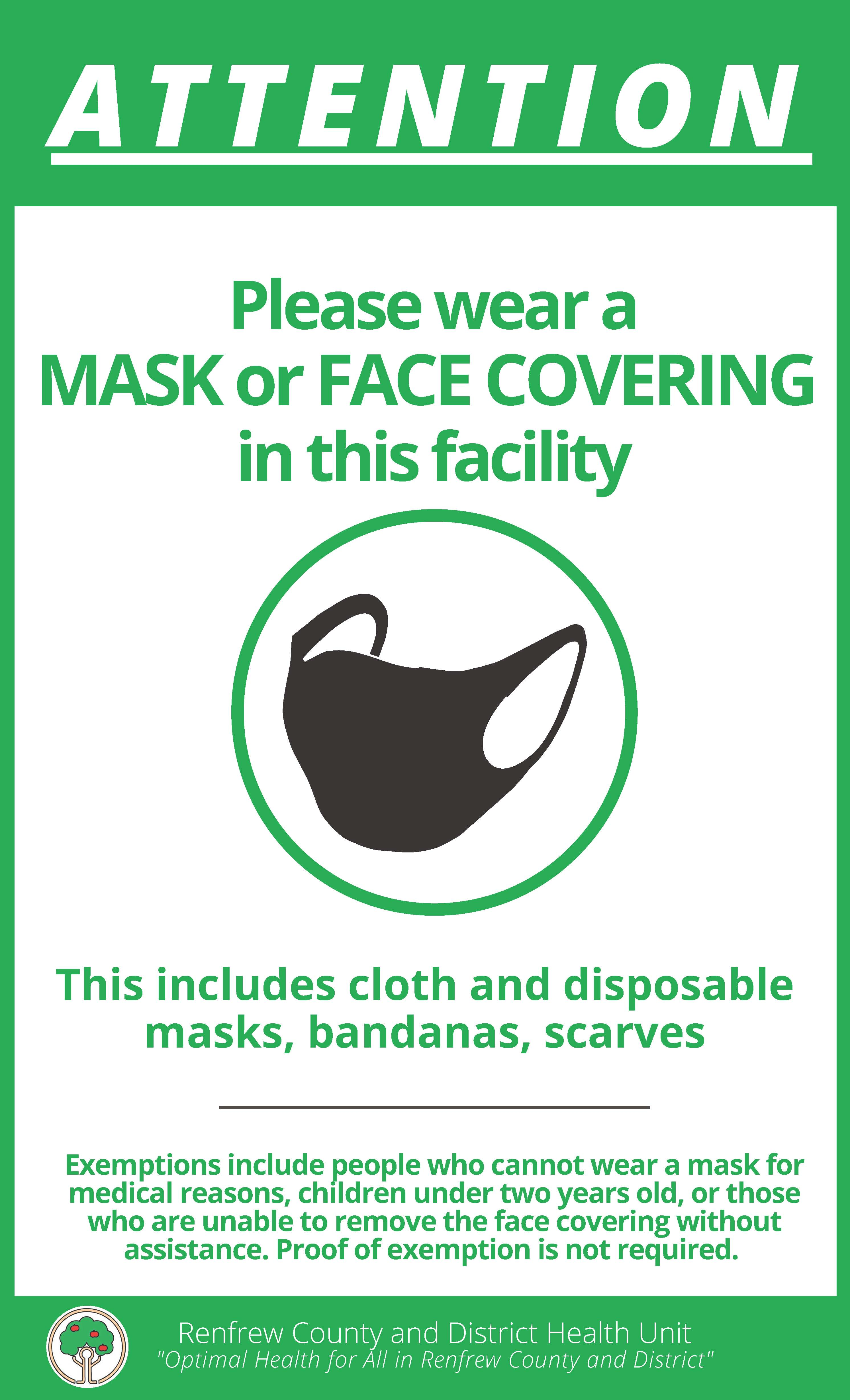 a green boarder with a black fabric mask and a listing of informtion detailing mask/face covering required