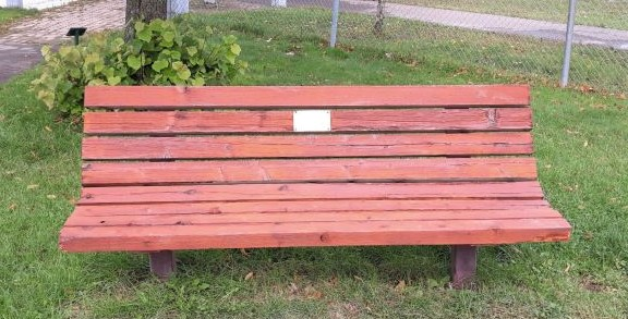 Image of bench with commemorative plaque