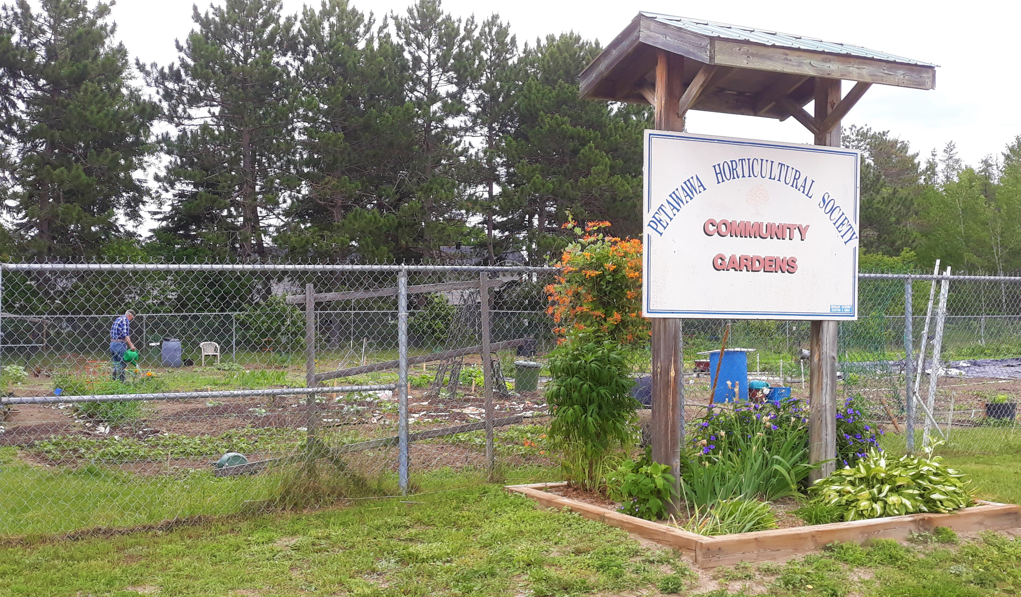 Image of front sign and garden plots at the Community Garden