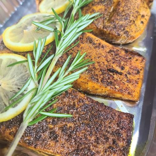 Image of fish fillets with herb and lemon