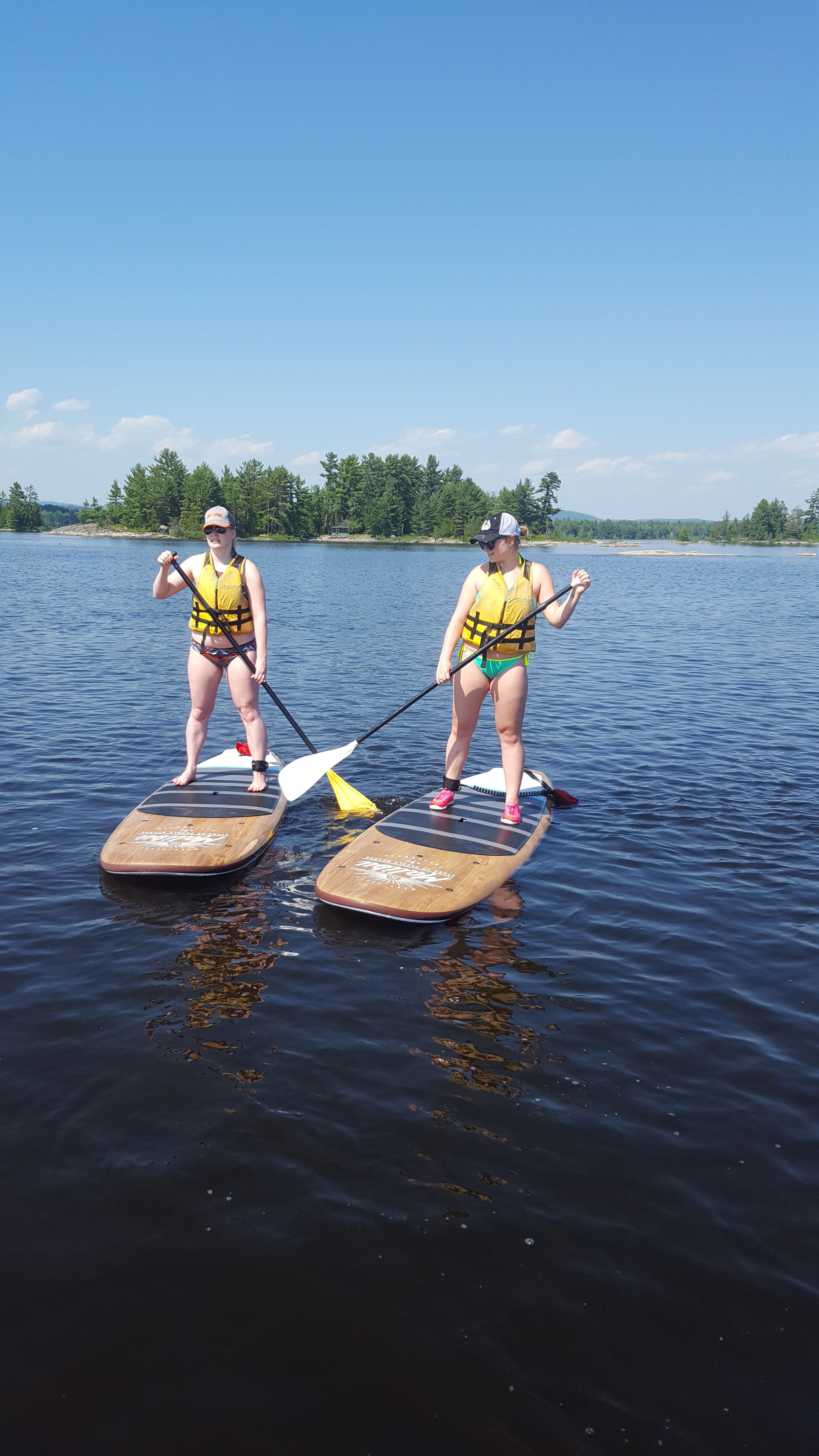 Image of 2 women on SUP boards on the Ottawa River