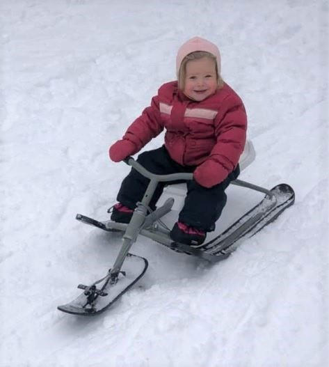 Image of toddler on a GT racer sliding down a hill in winter