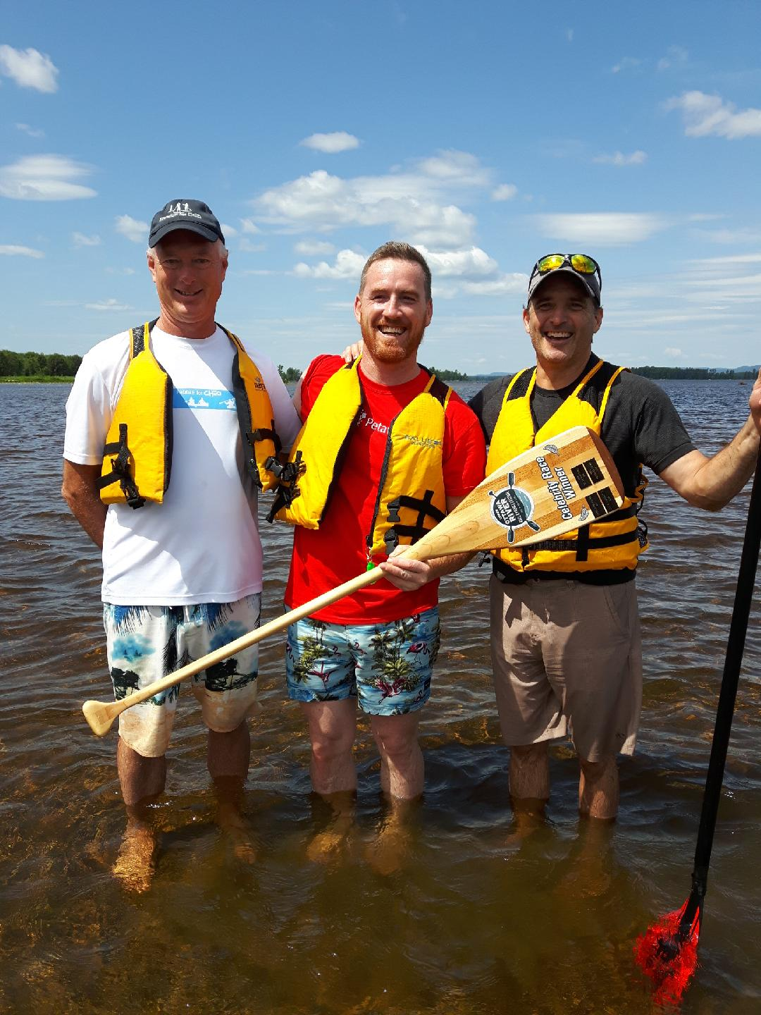 Image of 3 councillors in paddling gear at water's edge