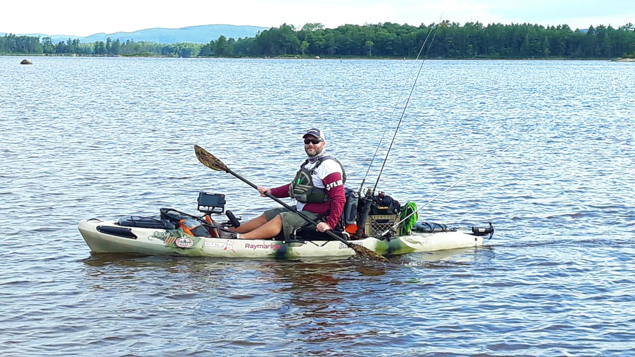 Image of kayaker with fishing gear